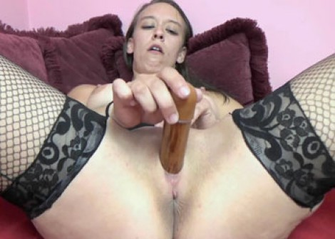 Nicci is masturbating with a new dildo